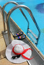 Summer still life by the pool with beach accessories Stock Images