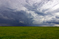 Summer Storm clouds above meadow with green grass Rising Thunderstorm Royalty Free Stock Photo