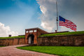 Summer storm clouds and American flag over Fort McHenry in Baltimore, Maryland. Royalty Free Stock Photo