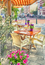 Summer street cafe dutch with flower pots Stock Image