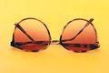 Summer sunglasses on a orange background Royalty Free Stock Photo