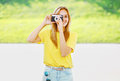 Summer sunny photo pretty hipster girl with vintage retro camera having fun in urban style Royalty Free Stock Images