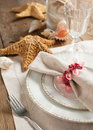 Summer table setting decorated with starfish and sea shell shells Stock Photography