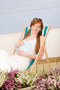 Summer terrace red hair woman relax in deckchair Stock Photos