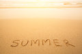 Summer - text written by hand in sand on a beach Royalty Free Stock Image