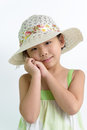 Summer theme portrait of little asian girl wearing hat Stock Photo