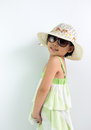 Summer theme portrait of little asian girl wearing hat and sunglasses Royalty Free Stock Images