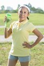 Summer thirst vertical portrait of a fit senior woman being thirsty after a workout Stock Image