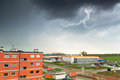 Summer thunderstorm over city buildings in poland Royalty Free Stock Photo