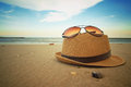 Summer time beach items on smooth sand Royalty Free Stock Photography