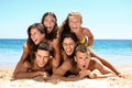 Summer time group of happy teens at the beach Royalty Free Stock Photography