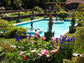 Summer time in park picture of the garden with pool Stock Photography