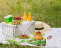 Summer time: picnic on the grass - coffee and croissants, juice Royalty Free Stock Photo