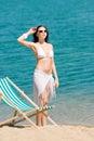 Summer toned woman sunbathing on beach in bikini Royalty Free Stock Photo