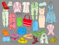 Summer travel packing for vacation. Woman clothing set. Vector hand drawn isolated objects. Colorful drawing fashion
