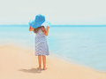Summer travel photo pretty little girl in dress and straw hat Royalty Free Stock Photo