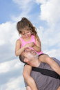 Summer trip father is carrying his daughter on his shoulders Royalty Free Stock Image