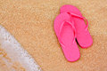 Summer vacation background flip flops on beach Royalty Free Stock Photo