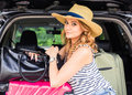 Summer vacation car road trip freedom concept. Happy woman cheering joyful during holiday travel with car. Royalty Free Stock Photo