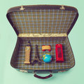 Summer vacation concept with suitcase and souvenirs from around the world over retro background Royalty Free Stock Photo