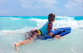 Summer vacation fun little boy on having swimming on boogie board Royalty Free Stock Images