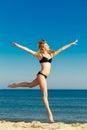 Summer vacation. Girl in bikini running on beach Royalty Free Stock Photo