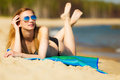 Summer vacation girl in bikini sunbathing on beach sexy tanning the young woman relaxing the sea coast summertime Royalty Free Stock Image