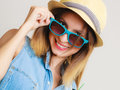 Summer vacation girl in sunglasses and straw hat happy clothes blue portrait of smiling woman tourist on gray Stock Photography