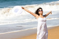 Summer vacation happiness on beach playful happy woman jumping running and dancing caucasian beautiful girl smiling and raising Stock Image