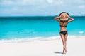 Summer vacation happiness carefree sun hat woman joyful standing on white sand enjoying tropical beach destination holiday bikini Stock Photo