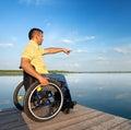Summer vacation man in wheelchair enjoying outdoors beach Stock Photography