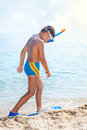 Summer vacation portrait of happy boy in face masks and snorke snorkels sea background Stock Photos