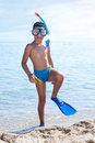 Summer vacation portrait of happy boy in face masks and snorke snorkels sea background Stock Photography