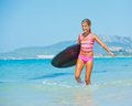 Summer vacation - surfer girl. Royalty Free Stock Photos