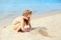 Summer vacation, travel concept - little girl child on beach playing Royalty Free Stock Photo