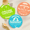 Summer vacation and travel labels and sea shells on a beach sand Stock Image