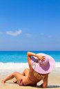 Summer vacation woman on beach the in hat enjoying holidays looking at the ocean Royalty Free Stock Photos