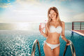 Summer Vacation. Woman in bikini on the inflatable mattress in the SPA swimming pool with coctail. Royalty Free Stock Photo