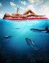 Summer vacation woman hanging out on air mattress with underwater part Royalty Free Stock Photo