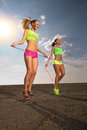 Summer vacation women with skipping rope Royalty Free Stock Photography