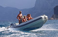 Summer vacationers in sardinia surf sun fun and a fast boat make for an enjoyable time for these Royalty Free Stock Images