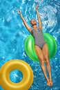 Summer Vacations. Woman Sunbathing, Floating In Swimming Pool Water