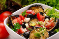 Summer vegetable salad with grilled eggplants, tomatoes, feta and olives. Royalty Free Stock Photo