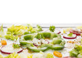 Summer vegetables in salad isolated on white background Stock Image