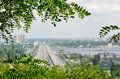 Summer view of kyiv wide river is dividing the city into right and left riverside both banks are overgrown with green trees and Stock Images
