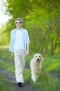 Summer walk portrait of cute lad and his fluffy friend walking outdoors Royalty Free Stock Images