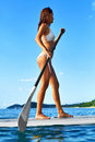 Summer Water Sports. Woman Paddling On Surfboard. Healthy Active Royalty Free Stock Photo