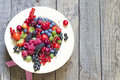 Summer wild berry fruits in the hat concept Royalty Free Stock Photo
