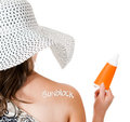Summer woman wearing sunblock Stock Images