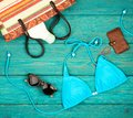 summer women& x27;s fashion with blue swimsuit, straw bag, purse, sun Royalty Free Stock Photo